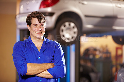 Buy stock photo Portrait of a confident male mechanic in the workshop