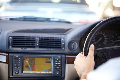 Buy stock photo Cropped image of a gps navigation system and a man's hands on the steering wheel of a car