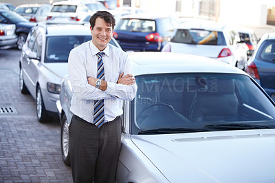 Buy stock photo A man standing confidently in a parking lot
