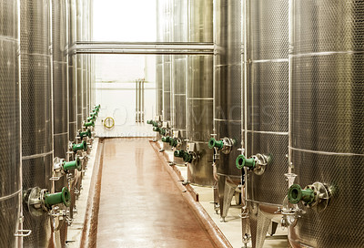 Buy stock photo Shot of the fermentation vessels inside a winemaking factory