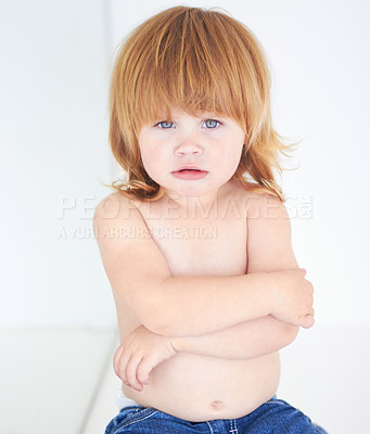 Buy stock photo A cute baby looking miserable with her arms folded