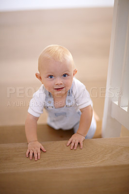 Buy stock photo Portrait of a cute toddler crawling up the stairs
