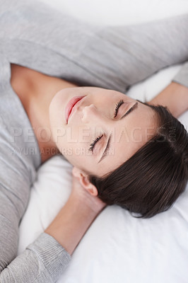 Napping - Closeup of a young woman with eyes closed on bed
