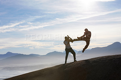 Buy stock photo Two male kickboxers fighting on a mountain top