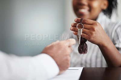 Buy stock photo Closeup of a receptionist handing over the hotel room keys to a senior patron