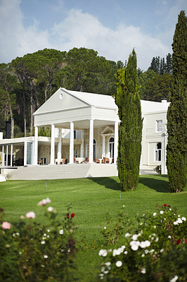 Buy stock photo A hotel manor surrounded by a well cultivated, picturesque garden