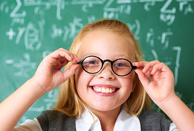 Buy stock photo Portrait of a cute blonde girl adjusting her glasses in class