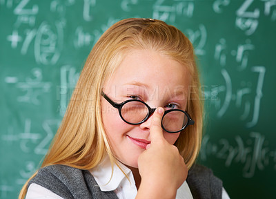 Buy stock photo Portrait of a cute blonde girl putting her glasses on in class