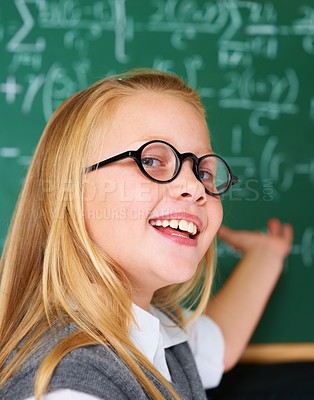 Buy stock photo Portrait of a cute blonde girl directing your attention to the board in class