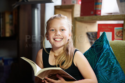 Buy stock photo Portrait of a cute blonde girl relaxed and reading on the sofa