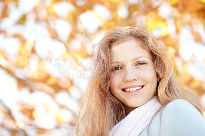 Buy stock photo Portrait of a pretty young girl standing outside under the autumn trees