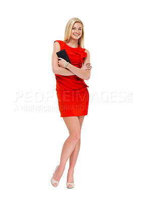 Buy stock photo A stunning young blonde woman in a red dress holding a clutch bag