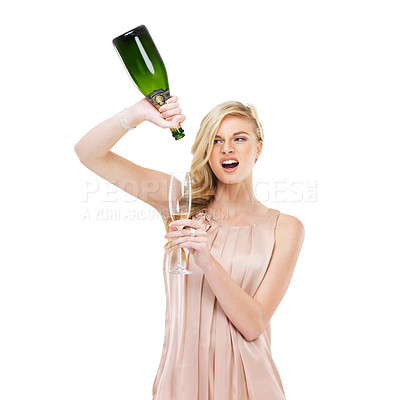 Buy stock photo A gorgeous young blonde woman pouring herself the last drop of champagne