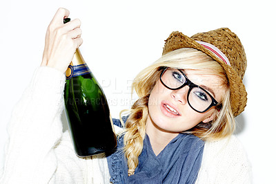 Buy stock photo Closeup of a gorgeous young woman holding a bottle of champagne against a white background
