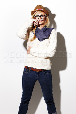Buy stock photo Portrait of a young woman holding a finger with a mustache drawn on it up to her nose
