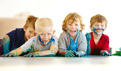 Buy stock photo Portrait of four cute little boys covered in paint