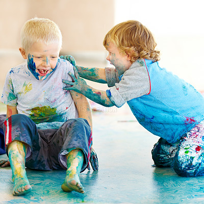 Buy stock photo Naughty little boys sitting on the floor and covered in paint