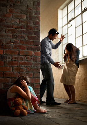 Buy stock photo Little girl huddled over while her father abuses her mother nearby