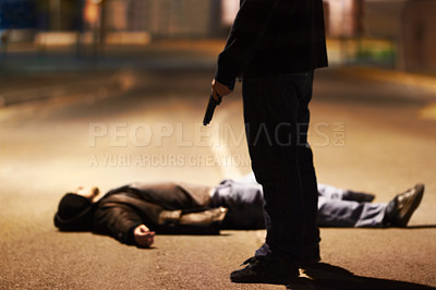 Buy stock photo Man lying on the ground after being shot by a gun-wielding criminal