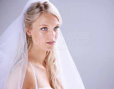 Buy stock photo Cropped shot of a beautiful young bride against a soft background
