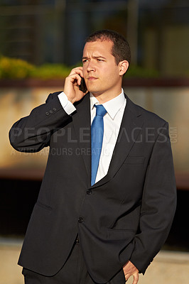 Buy stock photo A businessman talking on his cellphone