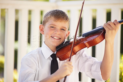 Buy stock photo Smiling young violinist holding his instrument proudly