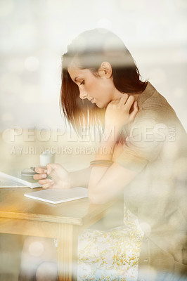 Buy stock photo Attractive young woman writing in her diary while in a coffee shop