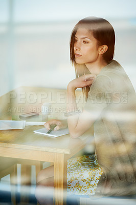 Buy stock photo Attractive young woman journalling in her diary while in a coffee shop