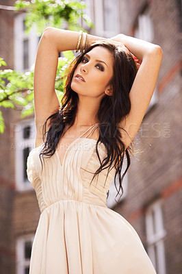 Buy stock photo A gorgeous young woman in a summer dress standing outside