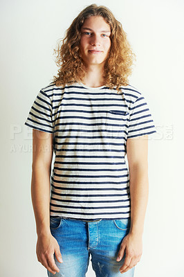 Buy stock photo Young man with curly long hair standing by himself
