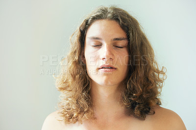 Buy stock photo Shirtless young man with long, curly hair closing his eyes