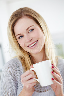 Buy stock photo Cute young woman drinking a cup of coffee with a smile