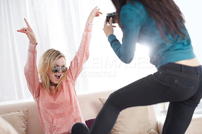 Buy stock photo Young woman striking a trendy pose for a friend taking a snapshot