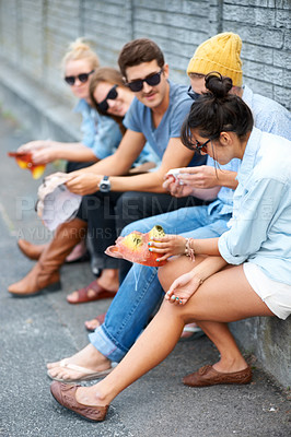 Buy stock photo Young hipster friends sitting together outdoors