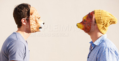 Buy stock photo Two young hipsters facing off while wearing animal masks