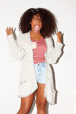 Buy stock photo Young African hipster screaming while standing against a white wall