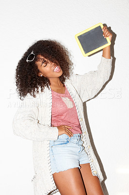 Buy stock photo Young African hipster holding a blank slate and leaning back