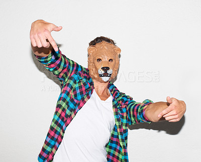 Buy stock photo Young hipster guy wearing a lion mask and gesturing