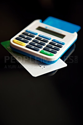 Buy stock photo A credit card underneath a calculator