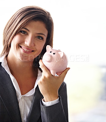 Buy stock photo Portrait of a businesswoman holding up a piggybank
