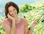 Happy mature woman talking on a cell phone