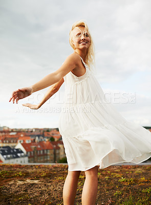 Buy stock photo A gorgeous young woman twirling