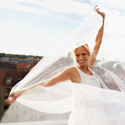 Buy stock photo A gorgeous young blonde woman surrounded by chiffon blowing in the wind