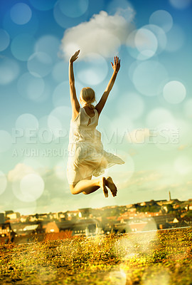 Buy stock photo A gorgeous young woman jumping with a city in the background