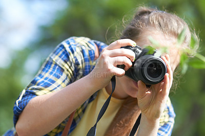 Buy stock photo A gorgeous young woman taking a picture with her camera