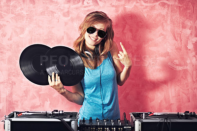 Buy stock photo Playful portrait of a dj gesturing and holding two vinyl records