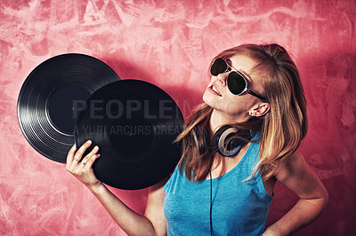 Buy stock photo A smiling young dj holding two records