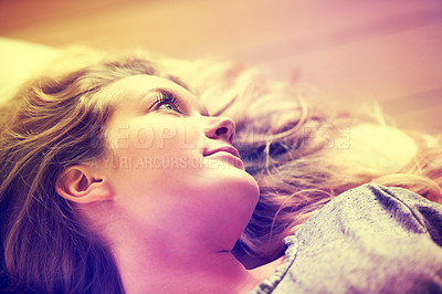 Buy stock photo An attractive young girl lying on her couch at home