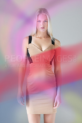 Buy stock photo Portrait of an attractive young female wearing a dress with colours floating around her