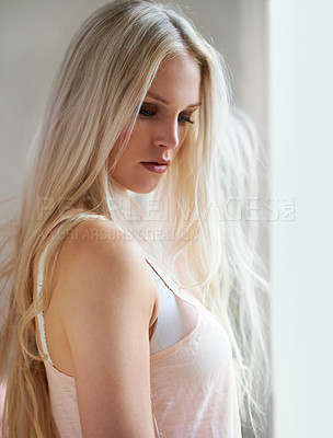 Buy stock photo An attractive young woman standing in her bedroom